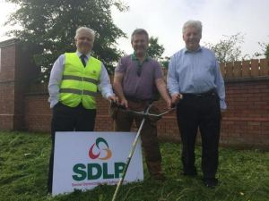 With SDLP colleagues cutting the grass verges, Primrose Hill, South Belfast